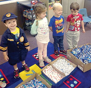 Preschoolers provide treats for officers