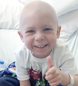 'He never stops smiling' -Proceeds from obstacle course will help young cancer patient