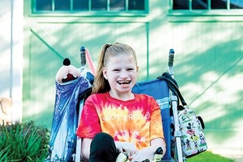 'She's always smiling'  Savana Jenkins is defying the odds of Angelman Syndrome