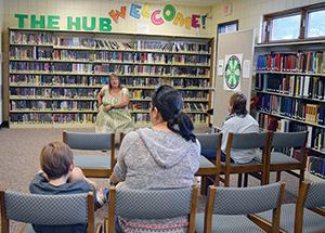 Storyteller visits library