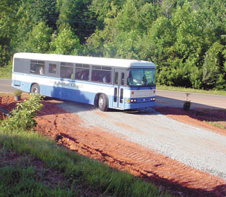 Busses Roll In To Help Refurbish Mullen Bible Camp in Lake Lure!