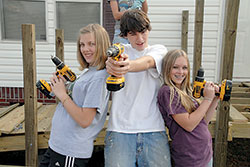 Helping Neighbors One Roof,  Nail or Board at a Time