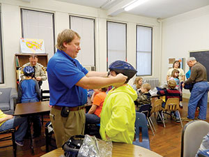 SafeKids gives out bike helmets to third graders