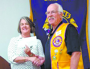 Lions Club presents donations; honor McCluney