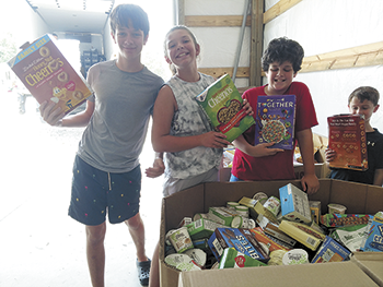 Children collect coins to purchase  15,000 pounds of food for WOCC